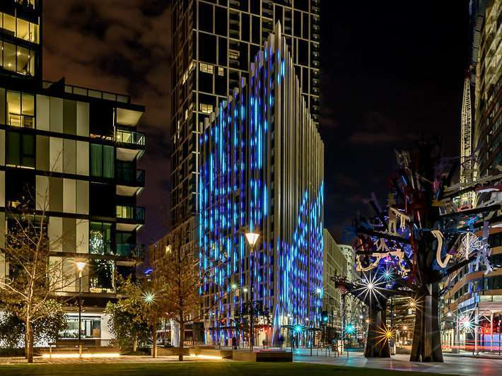 Lit up building facade at 888 Collins St
