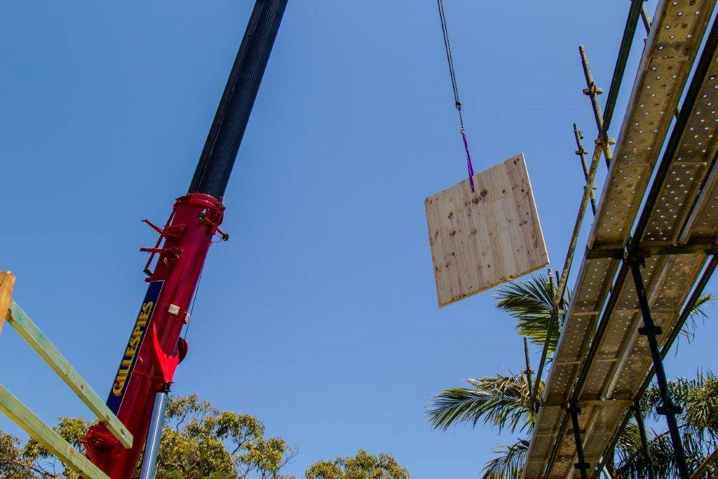 CLT panel suspended on crane