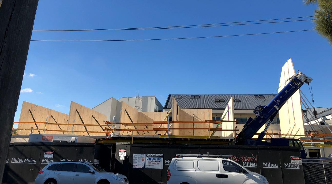 Townhouses under construction in CLT on Barry Street, Brunswick. The CLT walls are held in place with temporary propping.