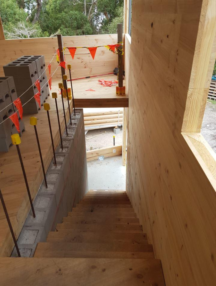 Interior and stairway of a CLT house under construction on Victoria's Coast