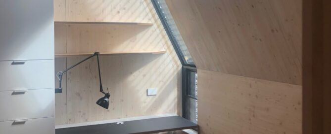 Exposed timber office nook with desk, storage, and windows. In Union St CLT House.