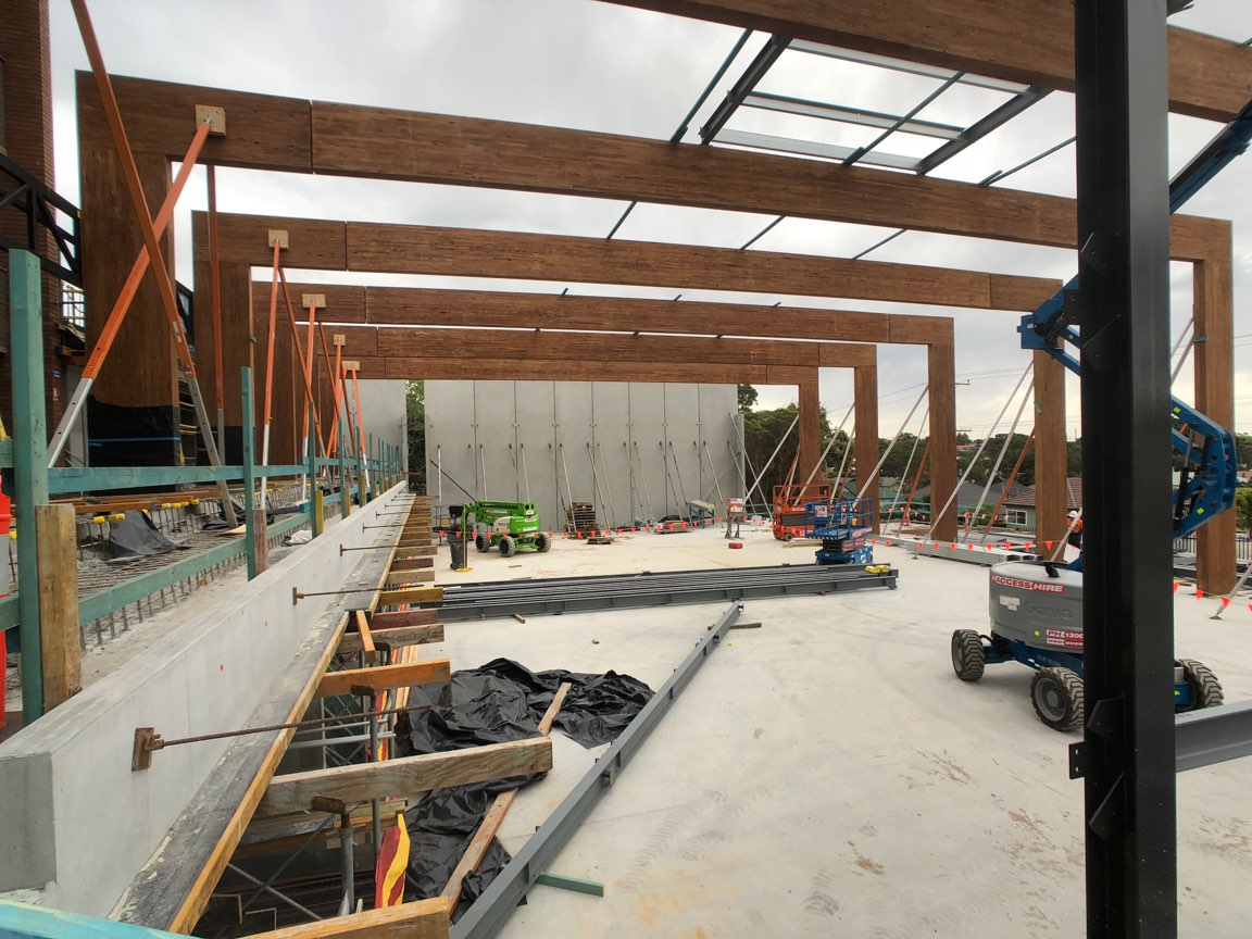 Massive Glulam beams, spanning the new San Clemente basketball court during construction