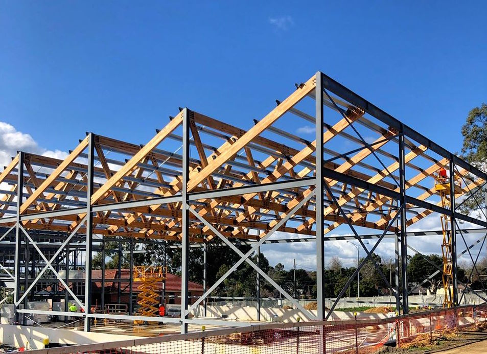Glulam trusses being installed