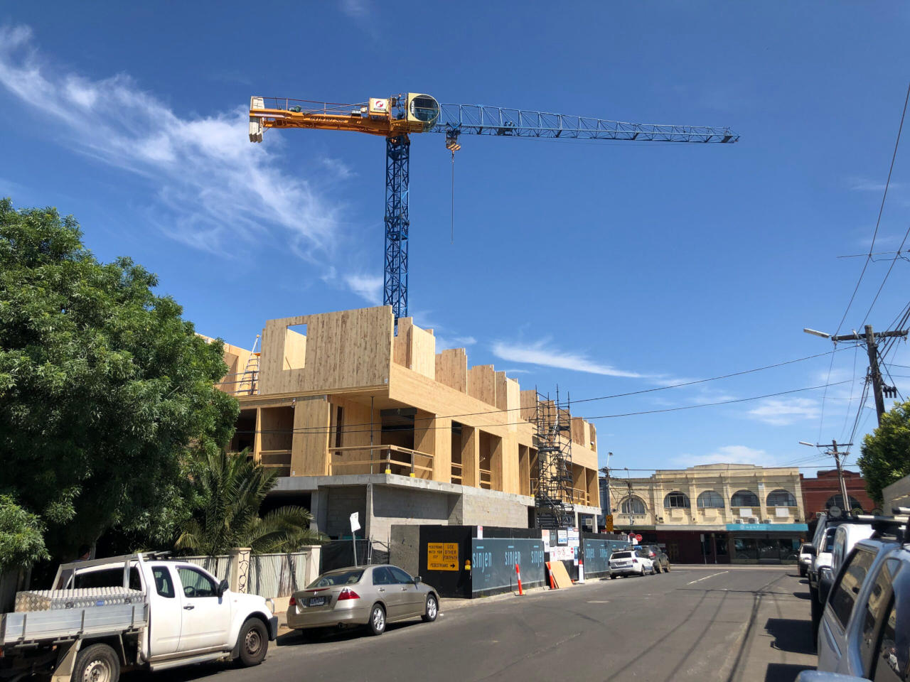 Crane above Mass Timber and concrete building under construction