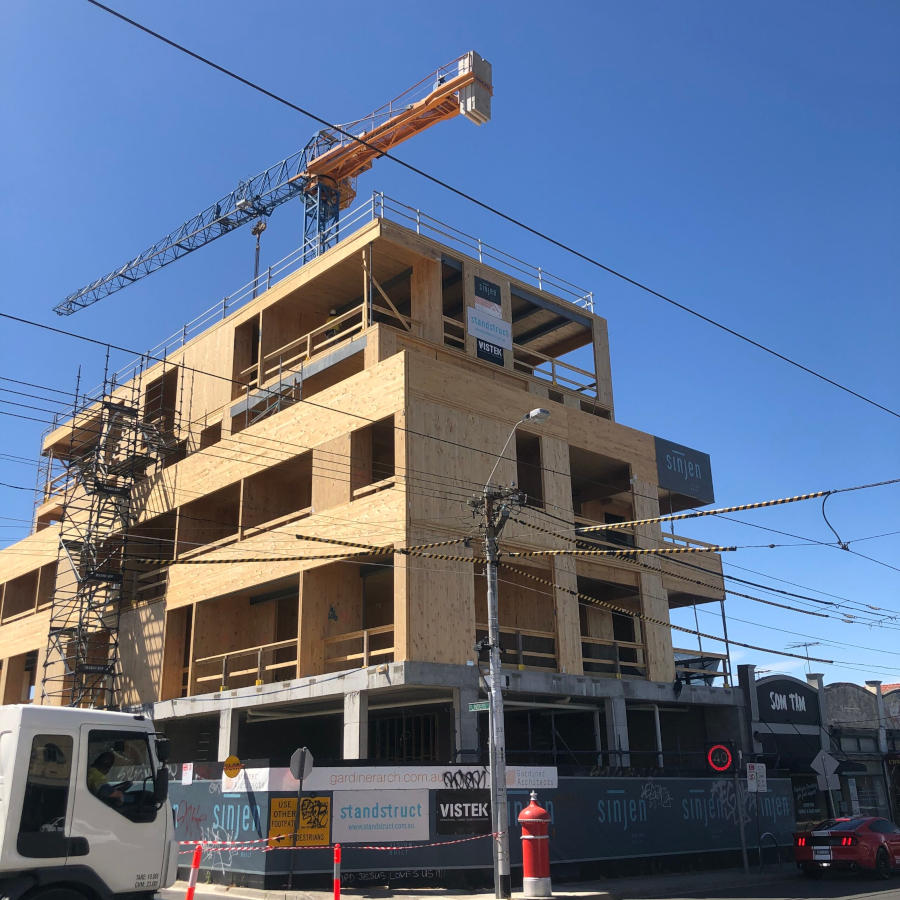 Mass Timber apartments under construction with signs including Gardiner Architects, Sinjen, Standstruct and Vistek