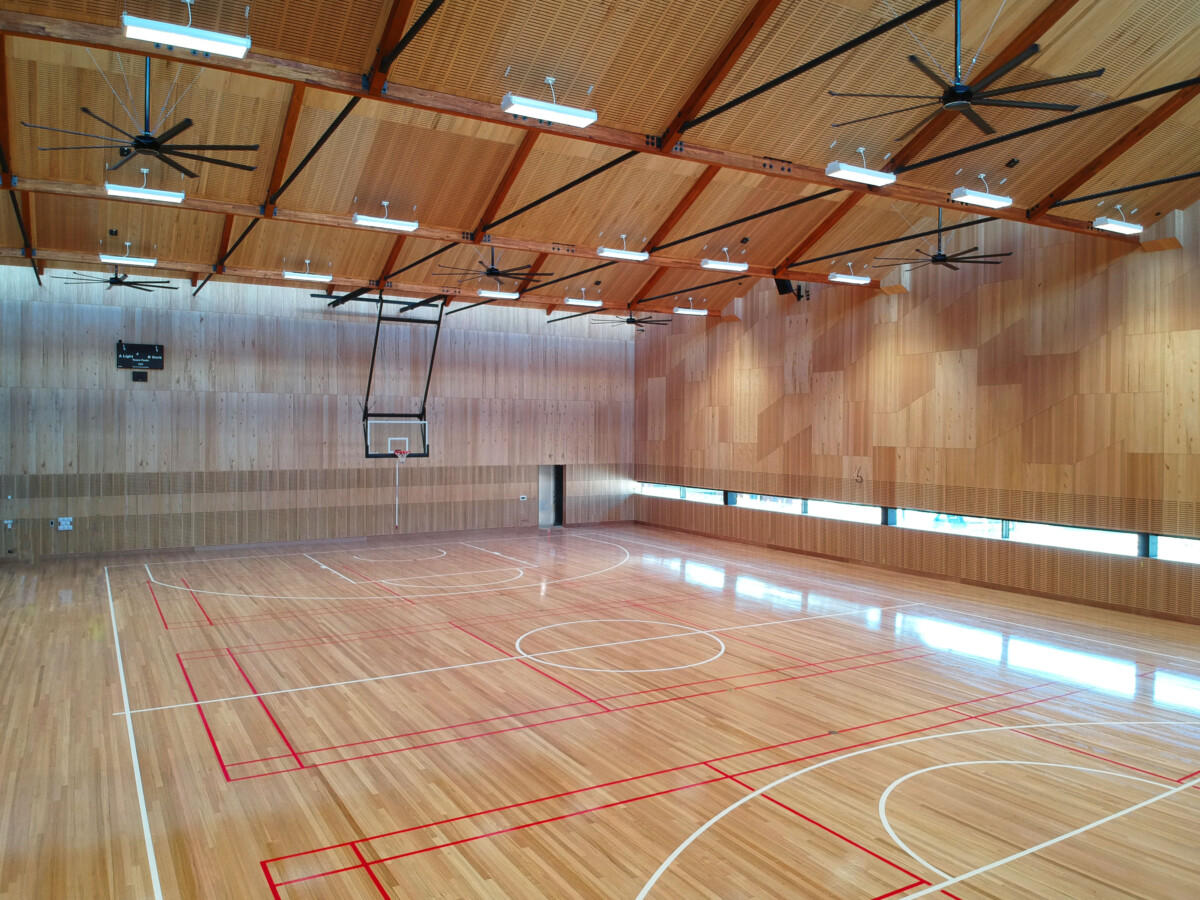 Wooden basketball court with Mass Timber beams