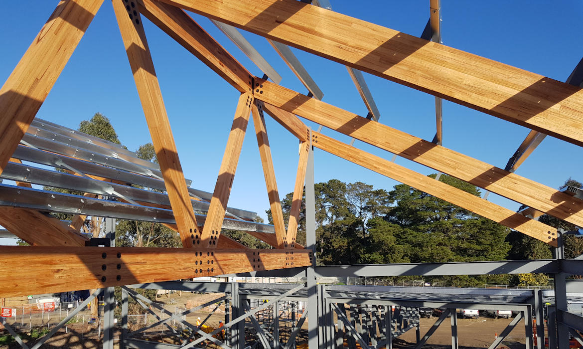 Glulam beams forming sawtooth roof during construction