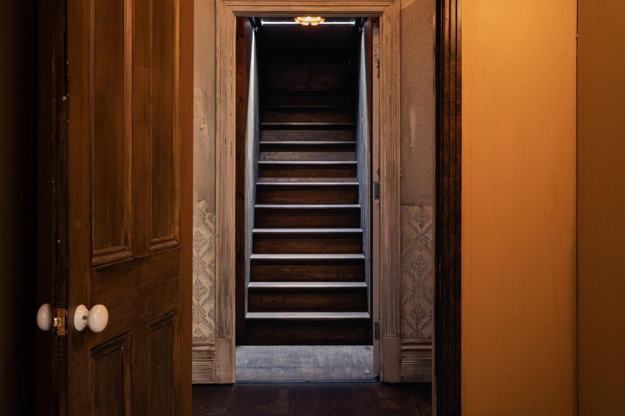 Stairway viewed through doorways in interior of '1000 Doors' installation