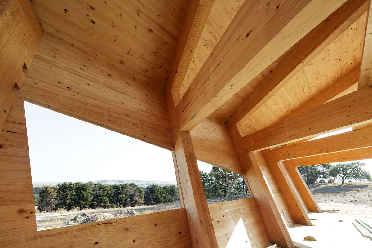 Glulam beams and CLT walls with windows during constuction