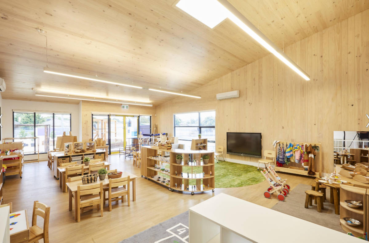 A childrens' classroom and play area with exposed CLT and Mass Timber floor, walls and ceiling at Oakleigh Childcare Centre