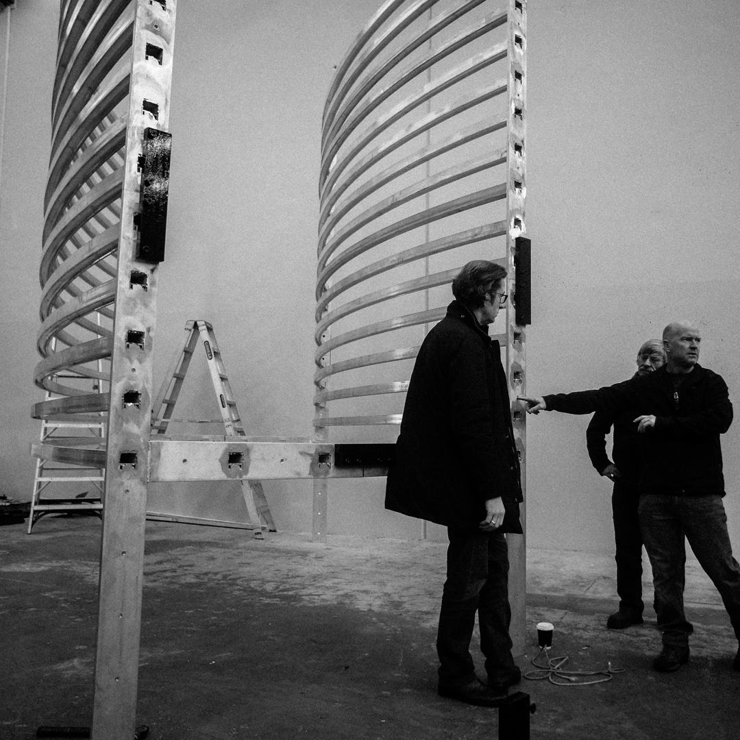 Sections of Asif Khan's Radiant Lines, curved shapes of illuminated aluminium, during construction
