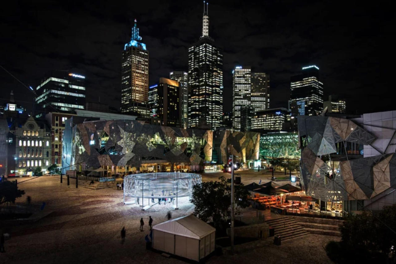 Federation Square at night with illuminated artwork Radiant Lines by Asif Khan, art installation engineered by Vistek